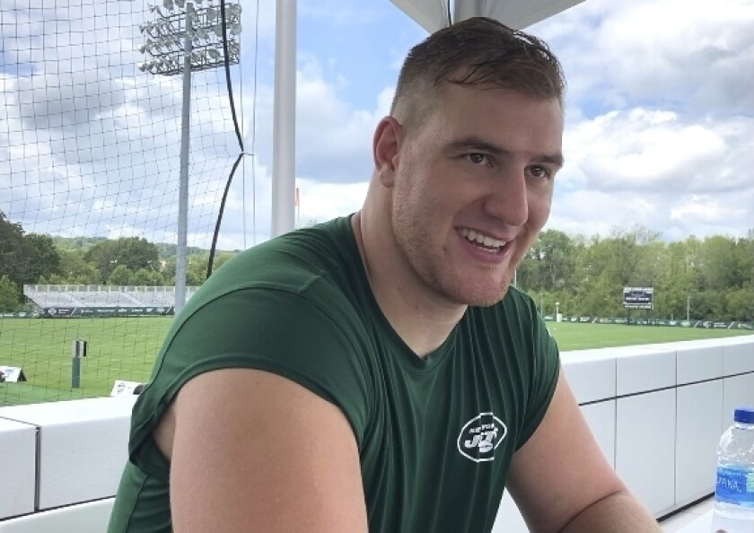 New York Jets NFL football offensive lineman Grant Hermanns speaks to a reporter after practice at the team's training facility in Florham Park, N,J., Monday Aug. 9, 2021. The 23-year-old undrafted rookie free agent out of Purdue is getting a chance to live out his NFL dream, working in training camp at both tackle spots as well as guard for the Jets. Hermanns is driven to succeed, motivated by having overcome a life-threatening staph infection that ravaged his body just a few years ago.(AP Photo/Dennis Waszak Jr.)