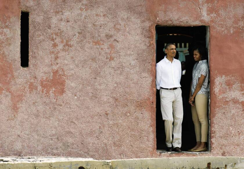 "In Senegal, President Obama and First Lady Michelle Obama look out from the ""door of no return"" at the Goree Island slave house, described as the exit for Africans boarding slave ships bound for America."