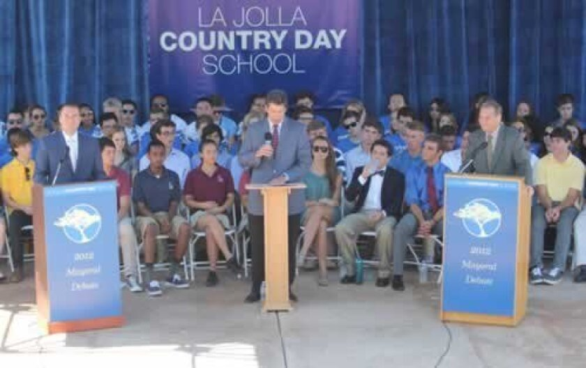 Mayoral candidates Carl DeMaio (left) and Bob Filner (right) take part in a debate at La Jolla Country Day School, moderated by Steve Dinkin (center) of the National Conflict Resolution Center. PAT SHERMAN