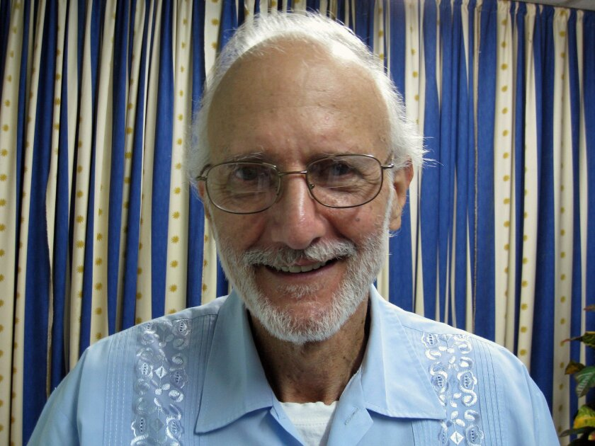 """FILE - In this Nov. 27, 2012, file photo, provided by James L. Berenthal, jailed American Alan Gross poses in Havana, Cuba. A lawyer for an American who has spent more than four years imprisoned in Cuba said Monday that his client cannot take life in prison much longer and has said his goodbyes to his wife and a daughter. Alan Gross was arrested in Cuba in 2009 while working covertly in the Communist-run country to set up Internet access. His attorney, Scott Gilbert, said in a statement Monday that his client """"has withdrawn"""" and told him """"life in prison is not a life worth living."""" Gross has previously said through his lawyer that his 65th birthday, which took place in May, would be the last one that he """"celebrates in Havana, one way or the other."""" (AP Photo/James L. Berenthal, File)"""