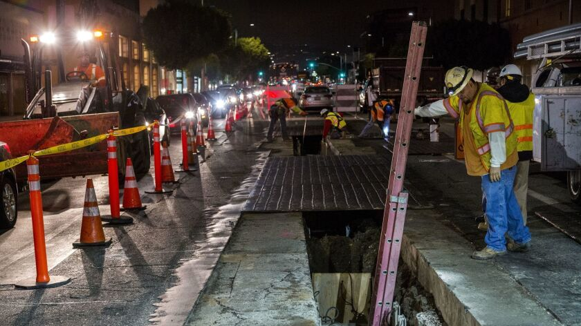 Metro workers prep to begin work on the Purple Line on Wilshire.