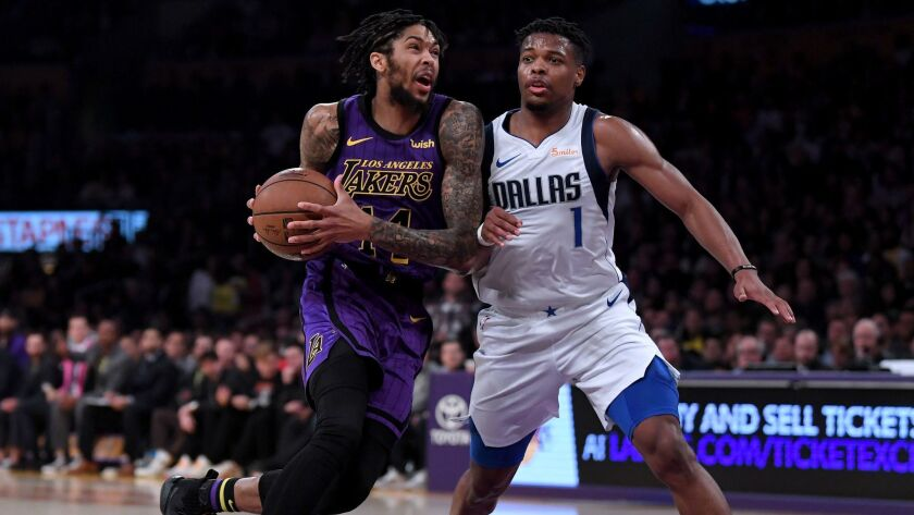 Brandon Ingram of the Lakers drives to the basket on Dennis Smith Jr. (1) of the Dallas Mavericks during a 114-103 Laker win at Staples Center on November 30, 2018.