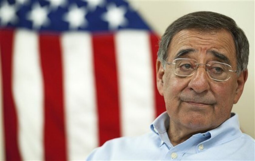 FILE - In this July 10, 2011 file photo Defense Secretary Leon Panetta listens to a reporter's question while making an unannounced visit to Camp Dwyer, in southern Afghanistan. (AP Photo/Paul J. Richards, Pool, File)