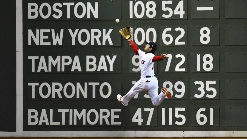 Boston Red Sox's Andrew Benintendi catches a fly ball hit by Los Angeles Dodgers' Brian Dozier durin