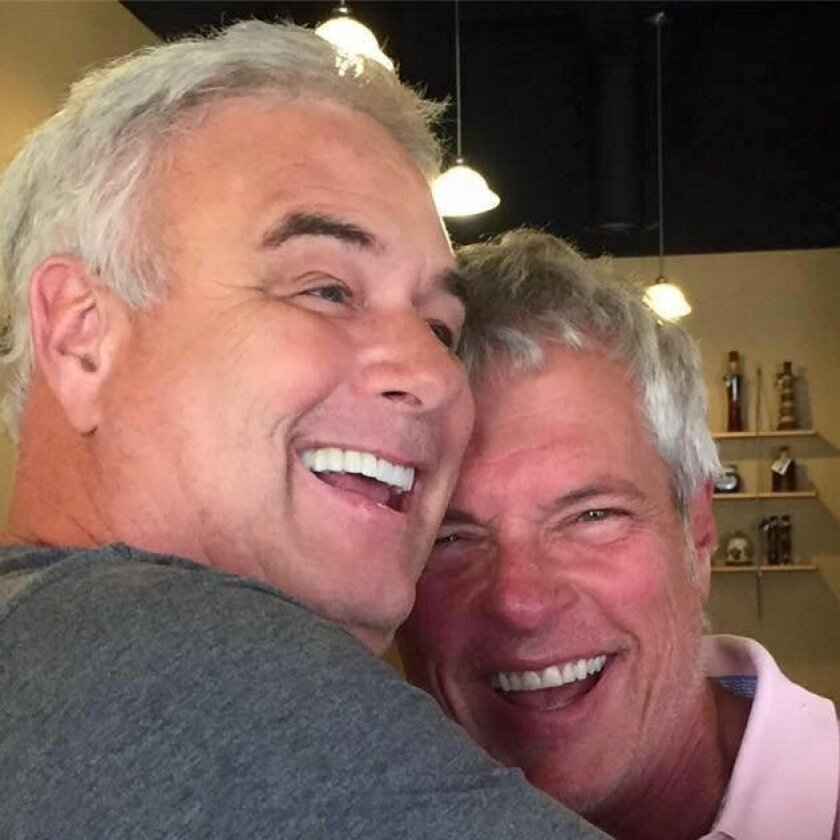 """Jeff Detrow, left, says goodbye to Jerry Cesak on Jerry's last day on KYXY radio's """"Jeff and Jer Showgram."""" The radio duo will be inducted into the National Radio Hall of Fame in November."""