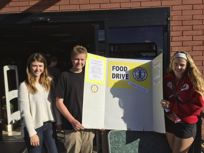 La Jolla High School students Olivia Murphey, Ian Brown and Interact Club president Maya Hildebrand collect food at the Ralphs grocery store in La Jolla Village Square shopping center. Courtesy