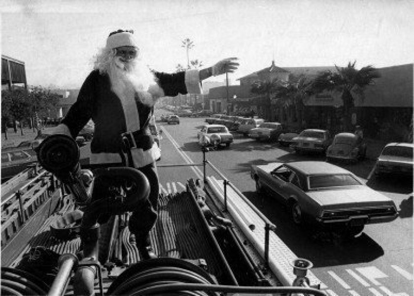 Kris Kringle makes his way down Girard Avenue atop a fire engine during the 1981 La Jolla Christmas Parade. Courtesy La Jolla Historical Society.