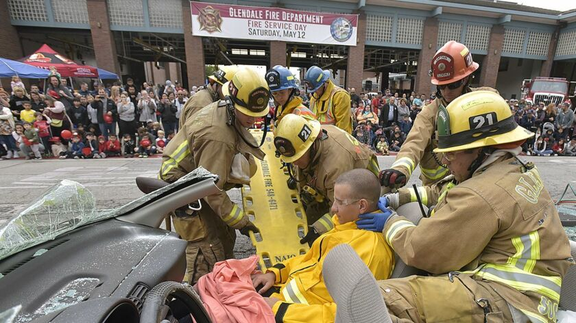Hundreds of attendees look on as Glendale Firefighters give a mock demonstration of how they might e