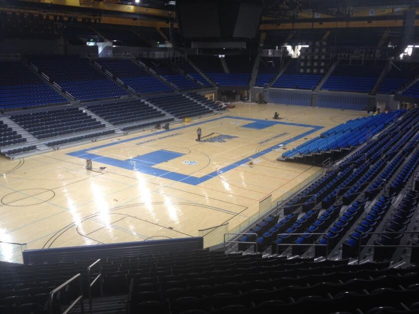 "The blue strip of court inside Pauley Pavilion in front of the team benches now features ""WESCOM"" in white block letters as part of a 10-year, $38-milllion sponsorship agreement between the credit union and the school."
