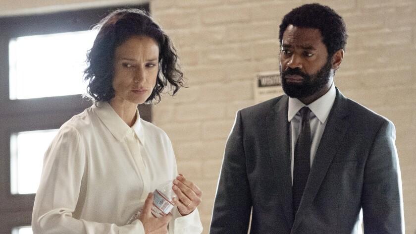 "Indira Varma and Nicholas Pinnock in ""For Life"" on ABC."