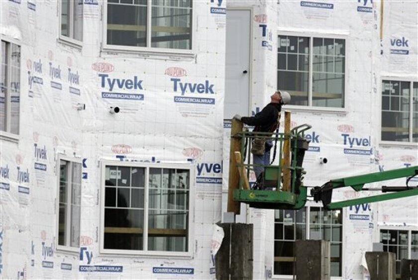 In this Friday, Jan. 11, 2013 photo, a construction worker works at a new home under construction in Chicago. U.S. homebuilders began work at a slower pace in January, though the level was still the third-highest since 2008. The pace of building was viewed as a sign of further strengthening in resi