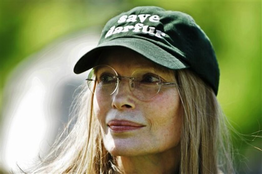 "FILE - Wearing a ""Save Darfur"" hat, actress Mia Farrow, joins a protest against the bloodshed in Darfur in front of the White House on April 29, 2007, in Washington. Farrow will turn 65 on Feb. 9, 2010. (AP Photo/Manuel Balce Ceneta)"