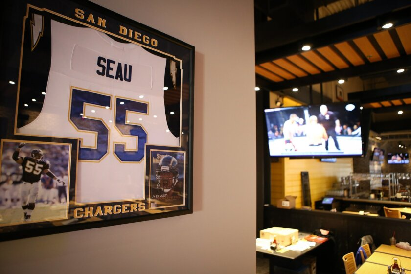 Junior Seau's jersey, along with those of a few other Chargers players, are displayed in the new Buffalo Wild Wings.