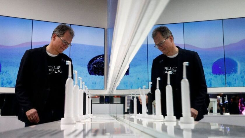 Hansjoerg Reick looks at a display of Oral-B Genius X smart toothbrushes at the Procter & Gamble booth on Jan. 7, 2019, before the CES International tech show in Las Vegas.