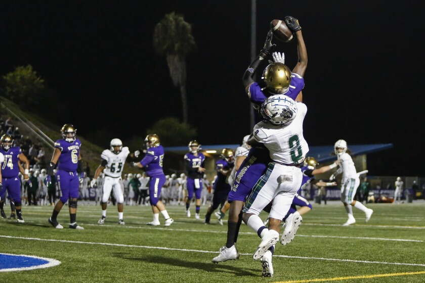 Helix High's Jaiden Brown (8), who has committed to SDSU, defends in a game last season against St. Augustine.