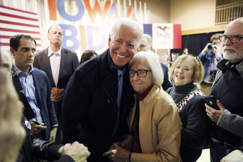 Democratic presidential candidate former Vice President Joe Biden gets a hug from Diane Burch, of Fort Dodge, Iowa, during a town hall meeting, Thursday, Oct. 31, 2019, in Fort Dodge, Iowa. (AP Photo/Charlie Neibergall)