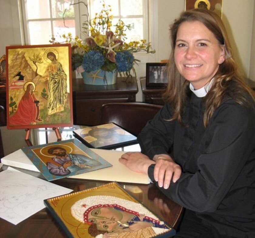 The Rev. Paige Blair, in her office at St. Peter's Church, surrounded by some of her icons. Photo/Lonnie Hewitt