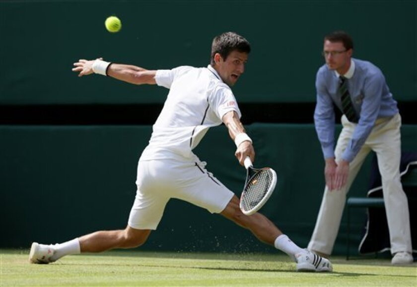 Novak Djokovic of Serbia plays a return to -Juan Martin Del Potro of Argentina during their Men's singles semifinal match at the All England Lawn Tennis Championships in Wimbledon, London, Friday, July 5, 2013. (AP Photo/Alastair Grant)