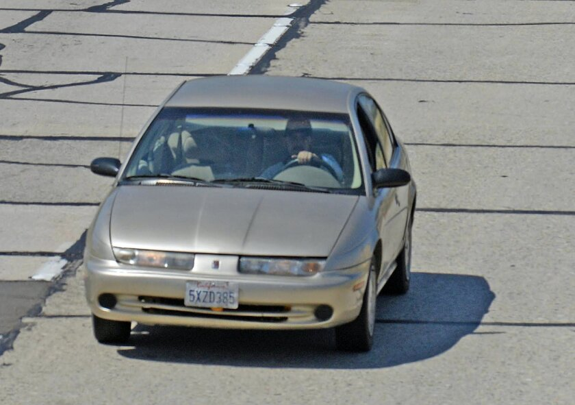 In this photo provided by the Santa Barbara County Fire Department, California Highway Patrol units pursue a car being sought in a statewide Amber Alert in the disappearance of a Northern California 15-year-old girl, as it passes through Buellton on U.S. Highway 101 in Southern California Thursday,
