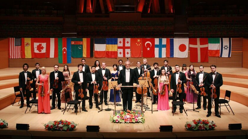 Maestro Eduard Schmieder, center, will lead the iPalpiti Orchestra as part of this year's edition of the iPalpiti Festival of International Laureates.