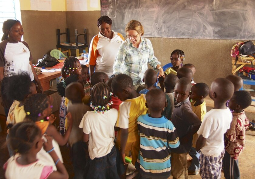 Agnes Barrelet, right, is executive director of Hands United for Children, which has built a preschool for children in Sapone, Burkina Faso. It has also built a dental clinic at O'Farrell Charter School in San Diego (below). Courtesy photos