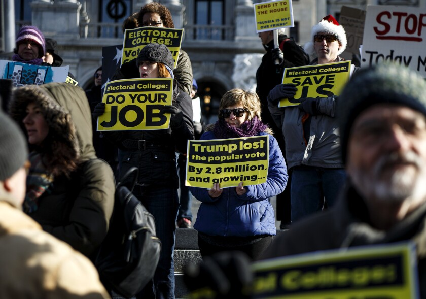 Protesters demonstrate ahead of the electoral college vote at the Pennsylvania State Capitol in 2016.