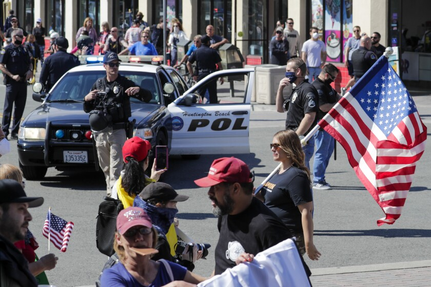 A big number of Trump supporters rally April 17 on Main Street in Huntington Beach against business closures due to COVID-19 pandemic.
