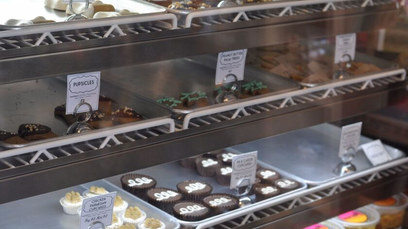 Trays filled with peanut butter and carob Hostess-like cupcakes for dogs at Naked Dog Bistro.