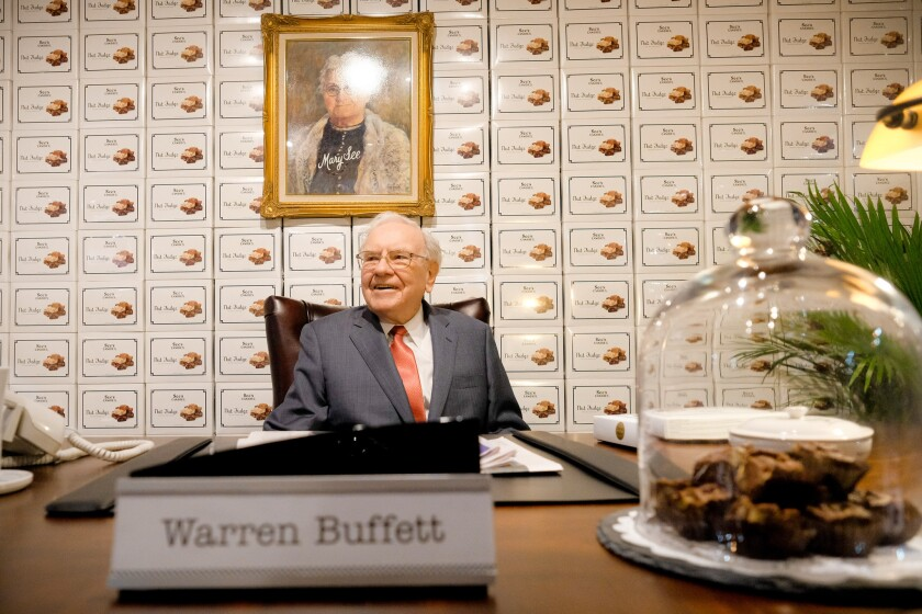 Warren Buffett sits at the See's Candies booth during the Berkshire Hathaway annual shareholders' meeting on April 29 in Omaha.