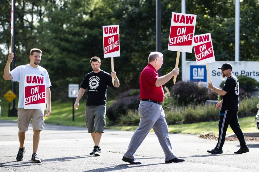 United Auto Workers members picket outside a General Motors facility in Langhorne, Pa., on Monday.