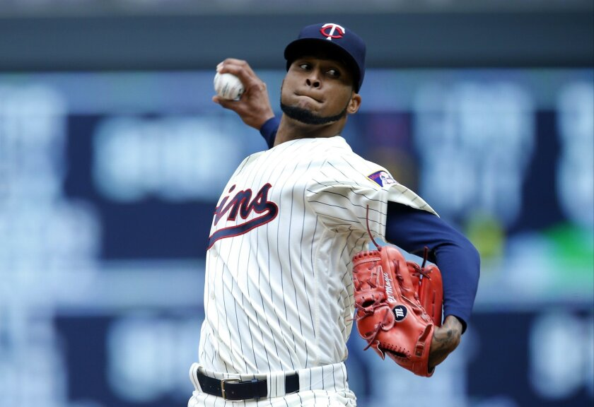 Minnesota Twins pitcher Ervin Santana throws against the Tampa Bay Rays in the first inning of a baseball game Saturday, June 4, 2016, in Minneapolis. (AP Photo/Jim Mone)