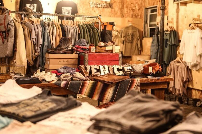 Men's and women's clothing on display at the Stash vintage pop-up at Das Shop.