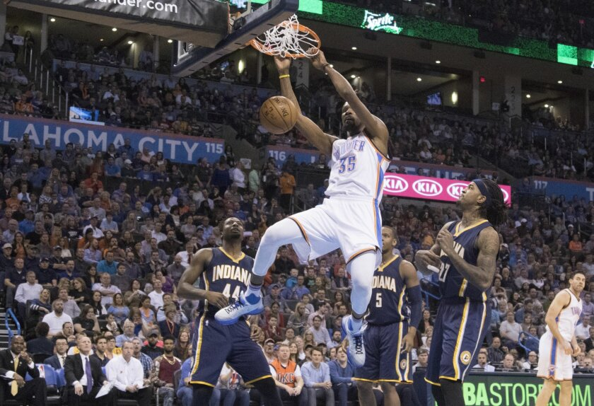 Indiana Pacers forward Solomon Hill (44), forward Lavoy Allen (5) and center Jordan Hill (27) watch Oklahoma City Thunder forward Kevin Durant (35) dunks for two points during the first half of an NBA basketball game in Oklahoma City, Friday, Feb. 19, 2016. (AP Photo/J Pat Carter)