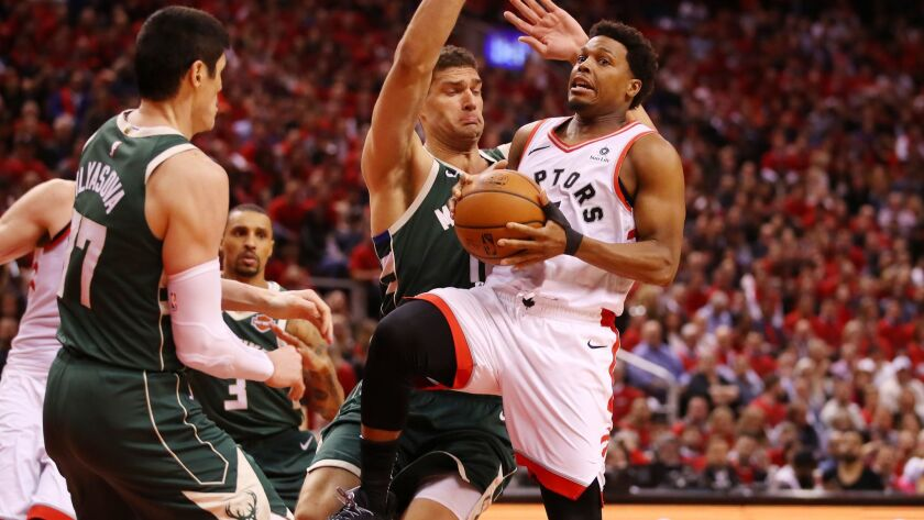 Toronto Raptors' Kyle Lowry (7) drives to the basket during the second half against the Milwaukee Bucks in Game 4 of the NBA Eastern Conference finals on Tuesday.