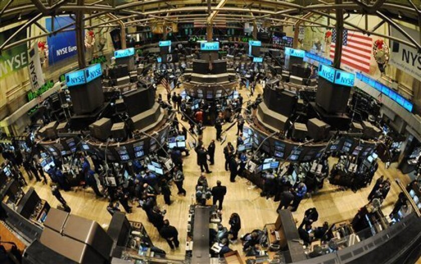 The floor of the New York Stock Exchange is abuzz with activity late on a down trading day, Wednesday, Jan. 7, 2009 in New York. A warning from tech giant Intel about poor business conditions and more evidence of rising unemployment upended some investors' hopes for a speedy economic recovery this