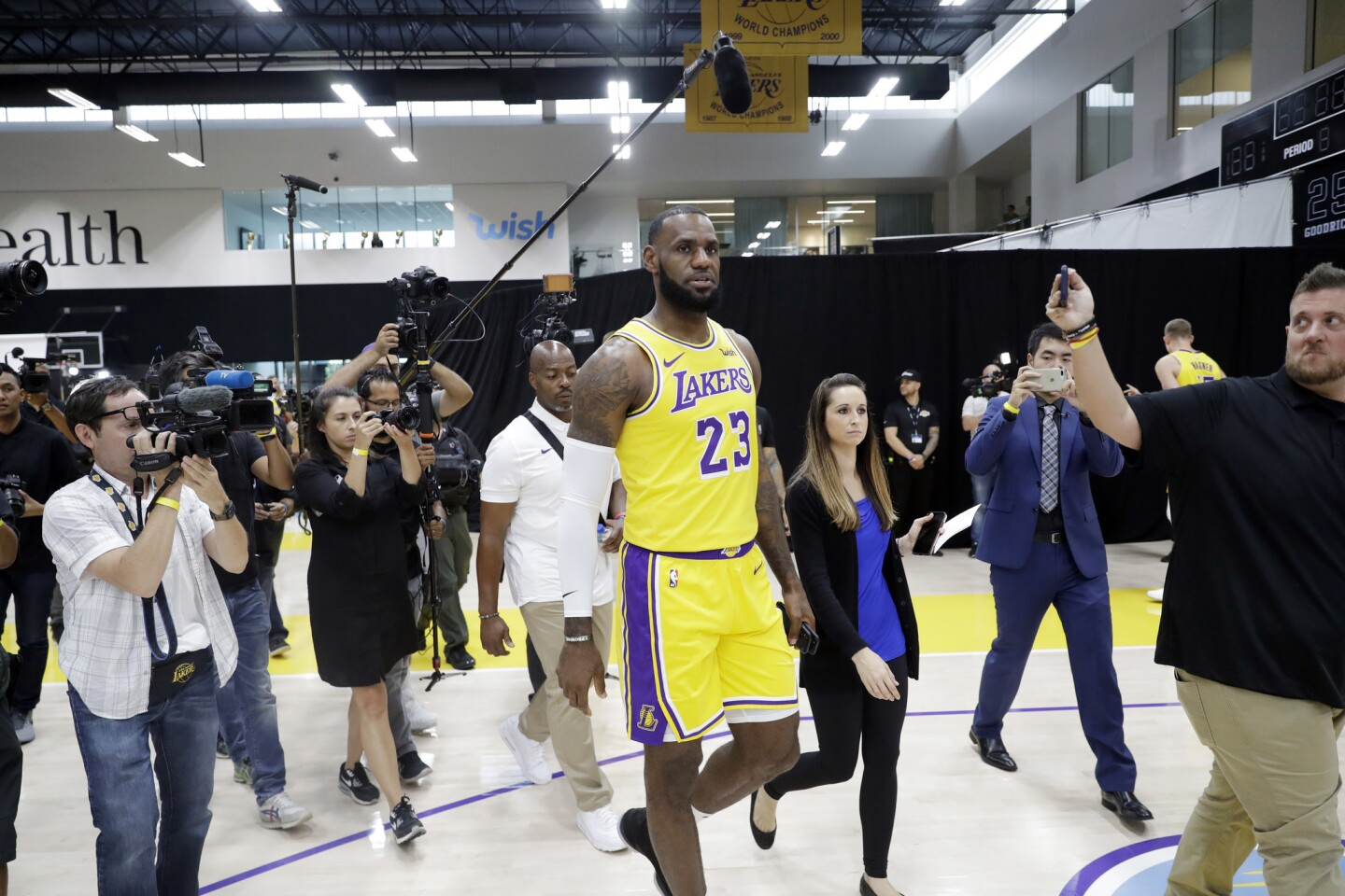 Members of the media follow Los Angeles Lakers' LeBron James (23) during media day at the NBA basketball team's practice facility Monday, Sept. 24, 2018, in El Segundo, Calif. (AP Photo/Marcio Jose Sanchez)