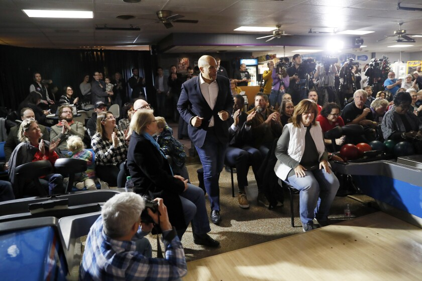 Sen. Cory Booker (D-N.J.) arrives at a campaign event in Adel, Iowa, on Friday.