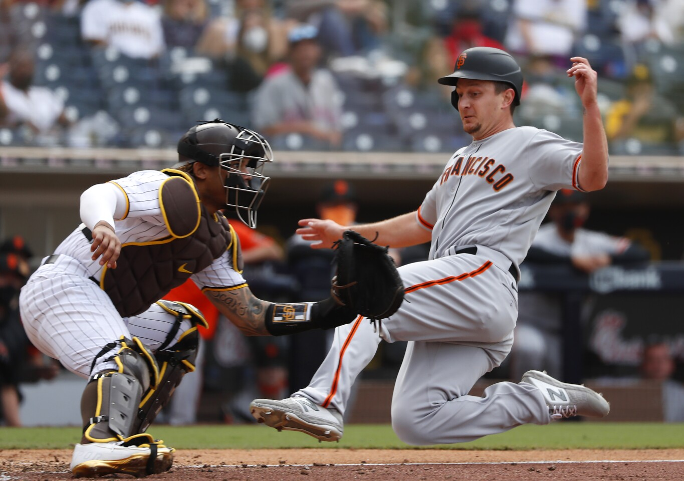 SAN DIEGO, CA - APRIL 7: San Diego Padres' Luis Campusano can't make the tag in time as San Francisco Giants' Alex Dickerson slides in for the game-winning run in the 10th inning at Petco Park on Wednesday, April 7, 2021 in San Diego, CA. (K.C. Alfred / The San Diego Union-Tribune)