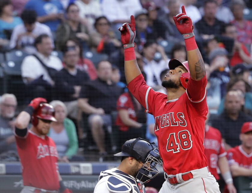 Los Angeles Angels' Cesar Puello (48) reacts as he crosses the plate after hitting a solo home run d