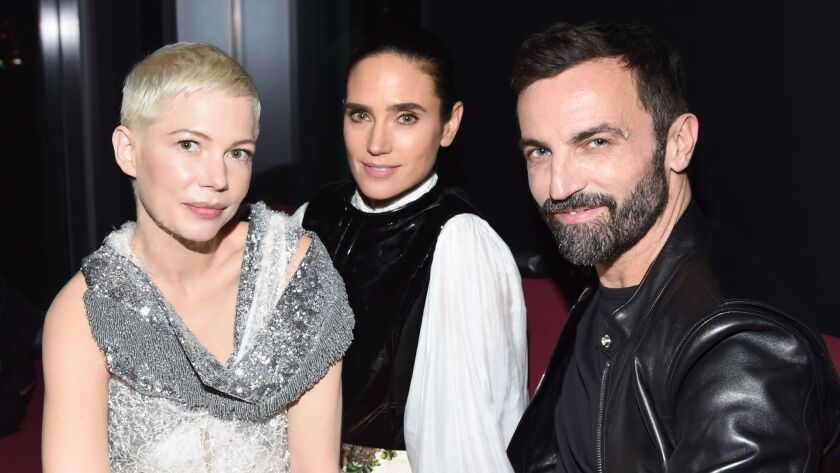 """Michelle Williams, from left, Jennifer Connelly and Nicolas Ghesquière at the Louis Vuitton """"Volez, Voguez, Voyagez"""" exhibition opening after-party in New York."""