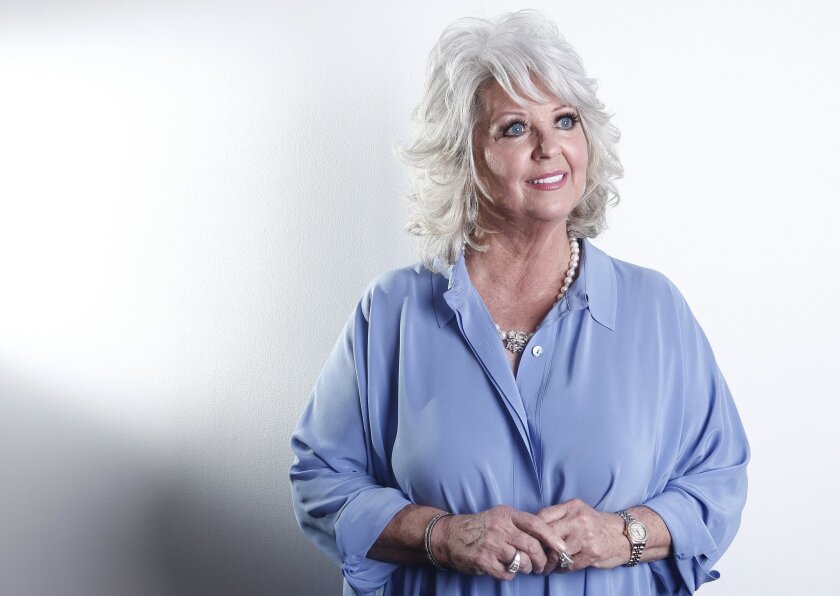 FILE - In this Jan. 17, 2012, file photo, celebrity chef Paula Deen poses for a portrait in New York. The Paula Deen Network, that is heavy on new videos starring the celebrity chef, goes live Wednesday, Sept. 24, 2014. (AP Photo/Carlo Allegri, File)