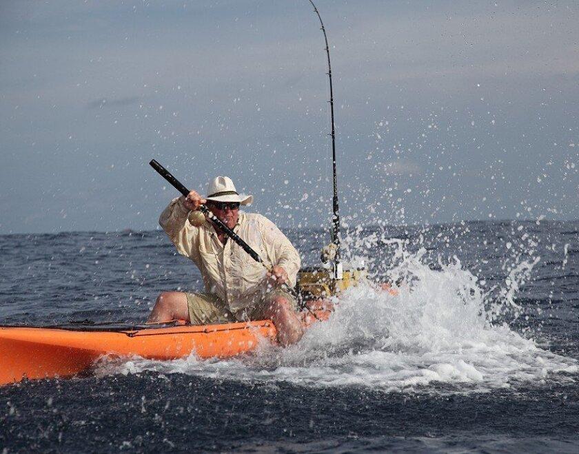 La Jolla-based kayak fisherman Jim Sammons attempts to gaff an estimated 120-pound yellowfin he hooked at the Hannibal Bank off Panama.