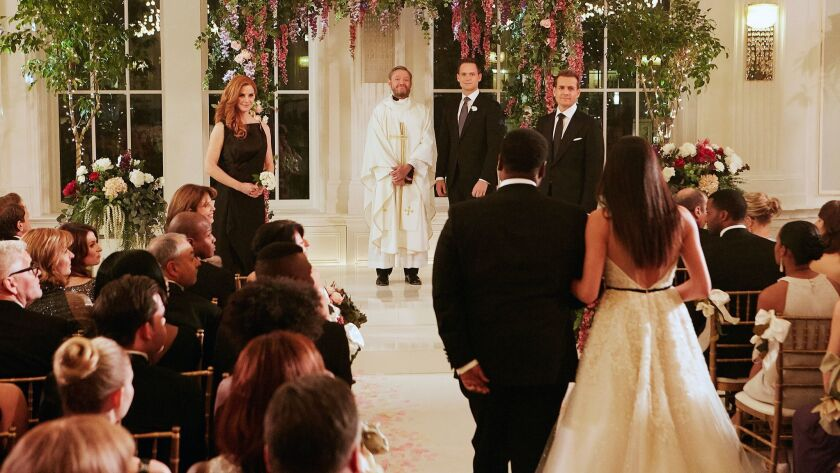 """This image released by USA Network shows a wedding scene from the """"Good-Bye"""" episode of """"Suits."""" Meg"""