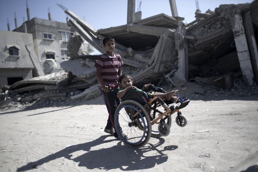 A Palestinian boy in Rafah with his brother, Ayman Mahmoum, who was injured during the war between Israel and Hamas militants in summer 2014.
