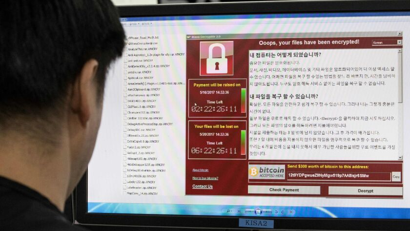 A photo taken on May 15, 2017 shows staff monitoring the spread of ransomware cyber-attacks at the K