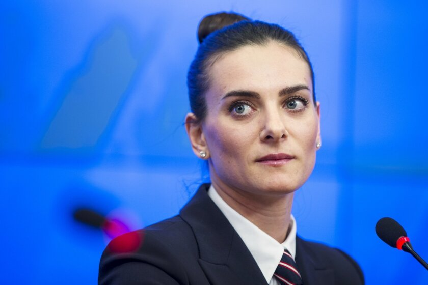 FILE - In this Thursday, Feb. 12, 2015 file photo, Russia's pole vaulter Yelena Isinbayeva attends a press conference in Moscow, Russia. Two-time Olympic pole vault champion Yelena Isinbayeva says on Monday, May 23, 2016 she will file suit if Russia's ban from global track and field competition is upheld and she is barred from competing in Rio de Janeiro. Russia's athletics federation was suspended by the IAAF after a World Anti-Doping Agency commission report detailed systematic, state-sponsored doping. The IAAF is due to rule next month on whether to reinstate Russia ahead of the Rio Games. (AP Photo/Pavel Golovkin, file)