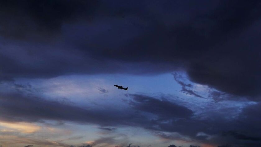 LLOS ANGELES, CALIF. - FEB. 14, 2019. A plane takes off from LAX under clearing skies after steady r
