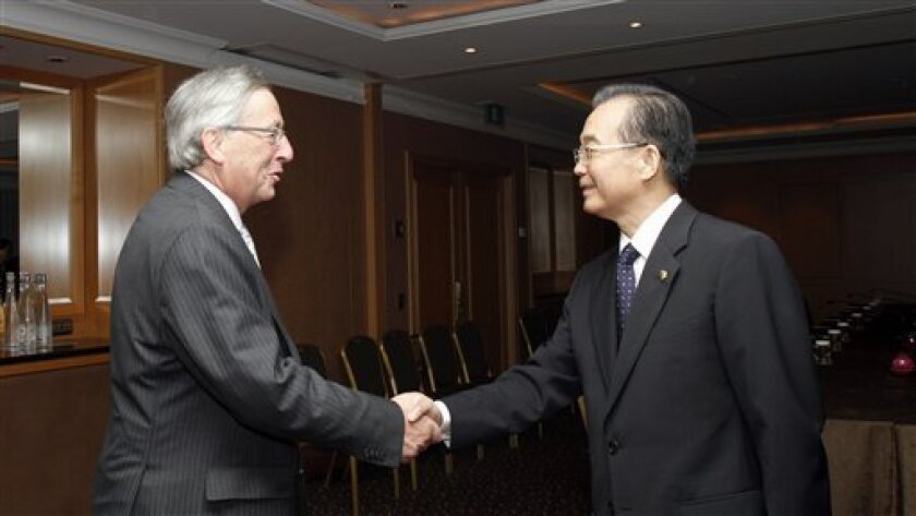 China's Prime Minister Wen Jiabao, right, shakes hands with Luxembourg's Prime Minister and head of the eurogroup Jean Claude Juncker during a meeting on the sidelines of an ASEM 8 summit in Brussels on Tuesday, Oct. 5, 2010. European and Asian leaders will seek common ground on ways to fix and regulate the global financial market but will likely be bogged down by such issues as market restrictions and trade surpluses during three days of summits. (AP Photo/Virginia Mayo)