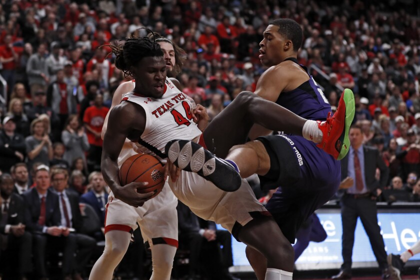 TCU's Jaedon LeDee, right, fouls Texas Tech's Chris Clarke (44) who rebounds the ball during the first half of an NCAA college basketball game Monday, Feb. 10, 2020, in Lubbock, Texas. (AP Photo/Brad Tollefson)