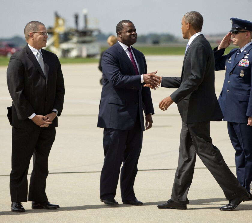 President Obama, right, is greeted by Atlanta Mayor Kasim Reed, center, and Fulton County Commissioner John Eaves, left, upon his arrival in Atlanta on Sept. 16.